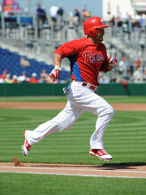 CLEARWATER, FL - FEBRUARY 24:  Outfielder Shane Victorino #8 of the Philadelphia Phillies runs at first base against the Florida State Seminoles February 24, 2011 at Bright House Field in Clearwater, Florida.  (Photo by Al Messerschmidt/Getty Images)
