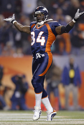 DENVER - NOVEMBER 3:  Tight end Shannon Sharpe #84 of the Denver Broncos celebrates a touchdown by running back Clinton Portis against the New England Patriots in the first quarter November 3, 2003 at Invesco Field at Mile High in Denver, Colorado.  (Phot
