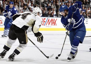 TORONTO, CANADA - FEBRUARY 26: Phil Kessel #81 of the Toronto Maple Leafs gets around Zbynek Michalek #4 of the Pittsburgh Penguins during game action at the Air Canada Centre February 26, 2011 in Toronto, Ontario, Canada. (Photo by Abelimages/Getty Image