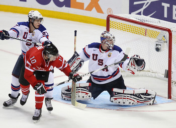 BUFFALO, NY - JANUARY 03: Jack Campbell #1 and Nick Bjugstad #27 of the United States defend against Brayden Schenn #10 of Canada during the 2011 IIHF World U20 Championship Semi Final game between United States and Canada on January 3, 2011 in Buffalo, N