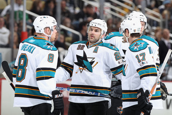 PITTSBURGH, PA - FEBRUARY 23:  (L-R) Joe Pavelski #8, Dan Boyle #22 and Torrey Mitchell #17 of the San Jose Sharks talk during the NHL game against the Pittsburgh Penguins at Consol Energy Center on February 23, 2011 in Pittsburgh, Pennsylvania.  The Shar