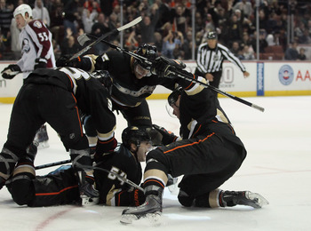 ANAHEIM, CA - FEBRUARY 27:  (clockwise from top) Luca Sbisa #5, Bobby Ryan #9, Brandon McMillan #64 and Jason Blake #33 of the Anaheim Ducks celebrate McMillan's go ahead goal in the third period against the Colorado Avalanche at Honda Center on February