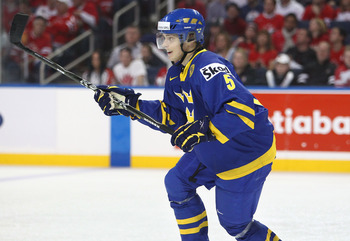 BUFFALO, NY - DECEMBER 31: Defenseman Adam Larsson #5 of Sweden during the 2011 IIHF World U20 Championship game between Canada and Sweden on December 31, 2010 at HSBC Arena in Buffalo, New York. (Photo by Tom Szczerbowski/Getty Images)