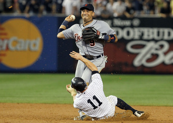 NEW YORK - AUGUST 16:  Carlos Guillen #9 of the Detroit Tigers completes a game ending double play after forcing out Brett Gardner #11 of the New York Yankees on August 16, 2010 at Yankee Stadium in the Bronx borough of New York City. The Tigers defeated
