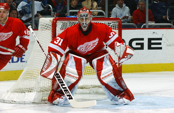 WASHINGTON - FEBRUARY 22:  Goalie Curtis Joseph #31 of the Detroit Red Wings protects the net during the game against the Washington Capitals at the MCI Center on Febuary 22, 2003 in Washington, DC. The Red Wings defeated the Capitals 5-1. (Photo by Mitch