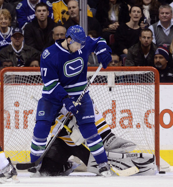 VANCOUVER, CANADA - FEBRUARY 26: Ryan Kesler #17 of the Vancouver Canucks deflects the puck wide of goalie Tim Thomas #30 of the Boston Bruins during the third period in NHL action on February 26, 2011 at Rogers Arena in Vancouver, British Columbia, Canad