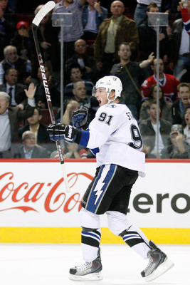 MONTREAL, CANADA - OCTOBER 13:  Steven Stamkos #91 of the Tampa Bay Lightning celebrates his third period goal during the NHL game against the Montreal Canadiens at the Bell Centre on October 13, 2010 in Montreal, Quebec, Canada.   The Lightning defeated