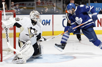 TORONTO, CANADA - FEBRUARY 26: Joffrey Lupol #19 of the Toronto Maple Leafs kicks the puck past Marc-Andre Fleury #29 of the Pittsburgh Penguins during game action at the Air Canada Centre February 26, 2011 in Toronto, Ontario, Canada. (Photo by Abelimage
