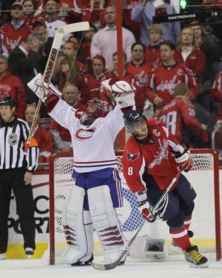 WASHINGTON - APRIL 28: Jaroslav Halak #41 of the Montreal Canadiens celebrates as Alex Ovechkin #8 of the Washington Capitals skates away following the Canadiens 2-1 win in Game Seven of the Eastern Conference Quarterfinals during the 2010 NHL Stanley Cup