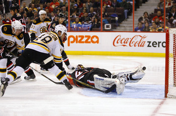 OTTAWA, CANADA - MARCH 01:  Nathan Horton #18 of the Boston Bruins chips a loose puck over a sprawling Craig Anderson #41 of the Ottawa Senators for the game winning goal at Scotiabank Place on March 1, 2011 in Ottawa, Canada.  (Photo by Phillip MacCallum