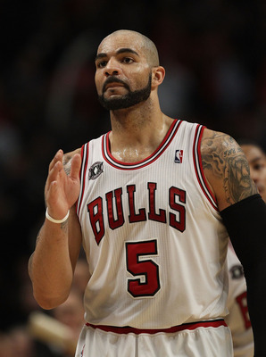 CHICAGO, IL - FEBRUARY 17: Carlos Boozer #5 of the Chicago Bulls waves to members of the San Antonio Spurs after a win at the United Center on February 17, 2011 in Chicago, Illinois. The Bulls defeated the Spurs 109-99. NOTE TO USER: User expressly acknow