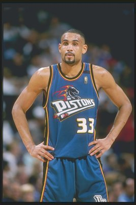 Forward Grant Hill of the Detroit Pistons stands on the court during a game against the Dallas Mavericks at Reunion Arena in Dallas, Texas. The Pistons won the game 100-82.
