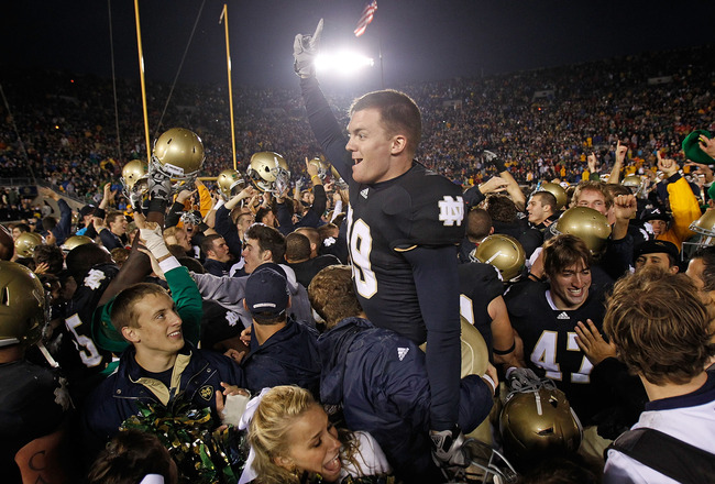 SOUTH BEND, IN - NOVEMBER 13: Ryan Sheehan #39 of the Notre Dame Fighting Irish is lifted by students while celebrating a win over the Utah Utes at Notre Dame Stadium on November 13, 2010 in South Bend, Indiana. Notre Dame defeated Utah 28-3. (Photo by Jo