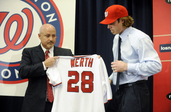 WASHINGTON, DC - DECEMBER 15:  Executive Vice President of Baseball Operations and General Manager Mike Rizzo (L) holds up a jersey as he introduces Jayson Werth #28  to the media on December 15, 2010 at Nationals Park in Washington, DC.   (Photo by Mitch