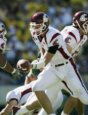EUGENE, OR - SEPTEMBER 27:  Quarterback Matt Kegel #4 of the Washington State University Cougars goes for the hand off against the University of Oregon Ducks at Autzen Stadium on September 27, 2003 in Eugene, Oregon. Washington State defeated Oregon 55-16
