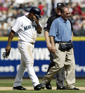 SEATTLE - AUGUST 28:  Adrian Beltre #5 of the Seattle Mariners is escorted off the field by trainer Rick Griffin after suffering an injury in the fifth inning against the Chicago White Sox on August 28, 2005 at Safeco Field in Seattle, Washington. The Mar