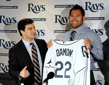 ST PETERSBURG, FL - FEBRUARY 01:  Executive Vice President of Baseball Operations Andrew Friedma (L) poses with Johnny Damon #22 of the Tampa bay Rays during a press conference at Tropicana Field on February 1, 2011 in St Petersburg, Florida.  (Photo by J