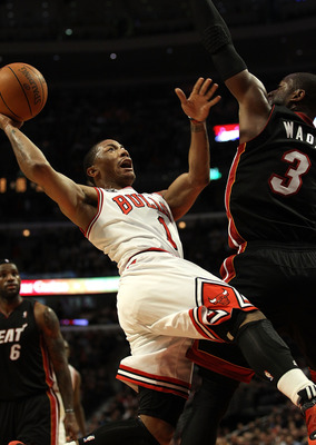 CHICAGO, IL - FEBRUARY 24: Derrick Rose #1 of the Chicago Bulls puts up a shot against Dwyane Wade #3 of the Miami Heat at the United Center on February 24, 2011 in Chicago, Illinois. The Bulls defeated the Heat 93-89. NOTE TO USER: User expressly acknowl
