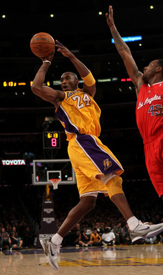 LOS ANGELES, CA - FEBRUARY 25:  Kobe Bryant #24 of  the Los Angeles Lakers passes off the ball in front of Rasual Butler #45 of the Los Angeles Clippers at Staples Center on February 25, 2011 in Los Angeles, California. The Lakers won 100-88.  NOTE TO USE
