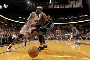 MIAMI, FL - FEBRUARY 25:  LeBron James #6 of the Miami Heat drives around Maurice Evans #6 of the Washington Wizards during a game at American Airlines Arena on February 25, 2011 in Miami, Florida. NOTE TO USER: User expressly acknowledges and agrees that