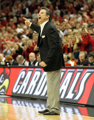 LOUISVILLE, KY - FEBRUARY 12:  Rick Pitino the Head Coach of the Louisville Cardinals gives instructions to his team during the Big East Conference game against the Syracuse Orange at the KFC Yum! Center on February 12, 2011 in Louisville, Kentucky.  Loui