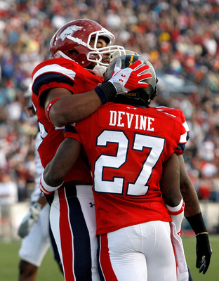 MOBILE, AL - JANUARY 29:  Running back Noel Devine #27 of the South team celebrates with tight end  D. J. Williams #45 after scoring a touchdown during the second quarter of the Under Armour Senior Bowl on January 29, 2011 at Ladd-Pebbles Stadium in Mobil