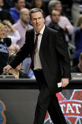 NASHVILLE, TN - MARCH 14:  Head coach Rick Stansbury of the Mississippi State Bulldogs coaches against the Kentucky Wildcats during the final of the SEC Men's Basketball Tournament at the Bridgestone Arena on March 14, 2010 in Nashville, Tennessee.  Kentu