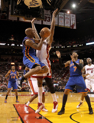 MIAMI, FL - FEBRUARY 27:  Chauncey Billups #4 of the New York Knicks drives against James Jones #22 of the Miami Heat during a game at American Airlines Arena on February 27, 2011 in Miami, Florida. NOTE TO USER: User expressly acknowledges and agrees tha