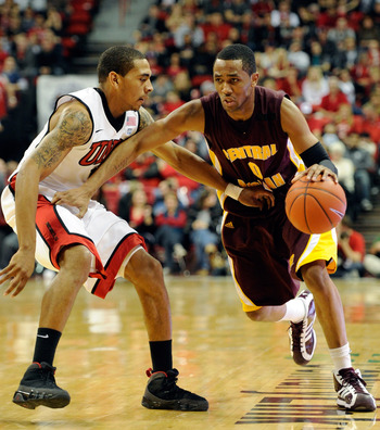 LAS VEGAS, NV - DECEMBER 30:  Trey Zeigler #0 of the Central Michigan Chippewas brings the ball up the court against Anthony Marshall #3 of the UNLV Rebels during their game at the Thomas & Mack Center December 30, 2010 in Las Vegas, Nevada. UNLV won 73-4