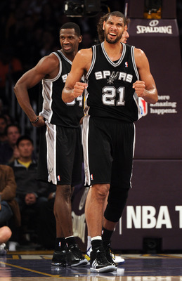 LOS ANGELES, CA - FEBRUARY 03:  Tim Duncan #21 and Antonio McDyess #34 of the San Antonio Spurs react to a basket along with a foul against the Los Angeles Lakers at Staples Center on February 3, 2011 in Los Angeles, California.  NOTE TO USER: User expres