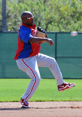 CLEARWATER, FL - FEBRUARY 19:  Infielder Jimmy Rollins #11 of the Philadelphia Phillies throws to first base during a spring training workout February 19, 2011 the Carpenter Complex at Bright House Field in Clearwater, Florida. (Photo by Al Messerschmidt/