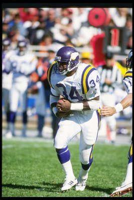 23 Sep 1990: Running back Herschel Walker of the Minnesota Vikings moves the ball during a game against the Chicago Bears at Soldier Field in Chicago, Illinois. The Bears won the game, 19-16.