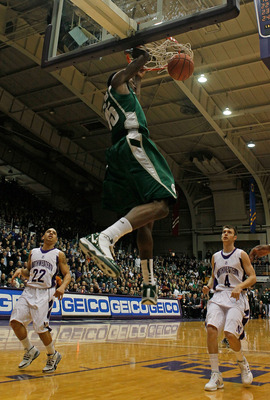EVANSTON, IL - JANUARY 02: Durrell Summers #15 of the Michigan State Spartans dunks the ball against Michael Thompson #22 and Alex Marcotullio #4 of the Northwestern Wildcats on January 2, 2010 at Welsh-Ryan Arena in Evanston, Illinois. (Photo by Jonathan