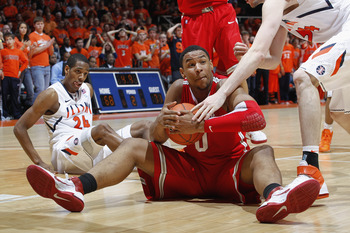 CHAMPAIGN, IL - JANUARY 22: Jared Sullinger #0 of the Ohio State Buckeyes signals for a timeout after stealing the ball late in the game against the Illinois Fighting Illini at Assembly Hall on January 22, 2011 in Champaign, Illinois. Ohio State won 73-68