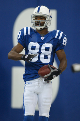 INDIANAPOLIS - SEPTEMBER 26: Marvin Harrison #88 of the Indianapolis Colts celebrates a touchdown catch against the Green Bay Packers at the RCA Dome on September 26, 2004 in Indianapolis, Indiana. (Photo by Jonathan Daniel/Getty Images)