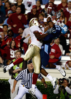 CHAPEL HILL, NC - OCTOBER 22:  Rod Owens #86 of the Florida State Seminoles battles for the football with North Carolina Tar Heels defender Deunta Williams #27 at Kenan Stadium on October 22, 2009 in Chapel Hill, North Carolina.  (Photo by Scott Halleran/