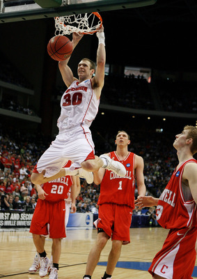 JACKSONVILLE, FL - MARCH 21: Jon Leuer #30 of the Wisconsin Badgers dunks against the Cornell Big Red during the second round of the 2010 NCAA men's basketball tournament at Jacksonville Veteran's Memorial Arena on March 21, 2010 in Jacksonville, Florida.