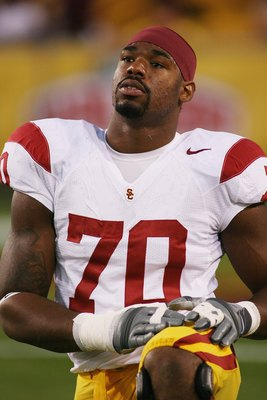TEMPE, AZ - NOVEMBER 7:  Tyron Smith #70 of the USC Trojans stretches before the game against the Arizona State Sun Devils on November 7, 2009 at Sun Devil Stadium in Tempe, Arizona.  USC won 14-9.  (Photo by Jeff Golden/Getty Images)