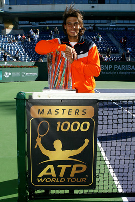 INDIAN WELLS, CA - MARCH 22:  Rafael Nadal of Spain poses with the championship trophy after defeating Andy Murray of Great Britain in the final of the BNP Paribas Open on March 22, 2009 at the Indian Wells Tennis Garden in Indian Wells, California.  (Pho