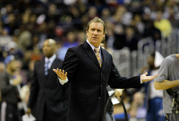 WASHINGTON, DC - FEBRUARY 26: Flip Saunders head coach of the Washington Wizards questions an officials call against the Dallas Mavericks at the Verizon Center on February 26, 2011 in Washington, DC. NOTE TO USER: User expressly acknowledges and agrees th