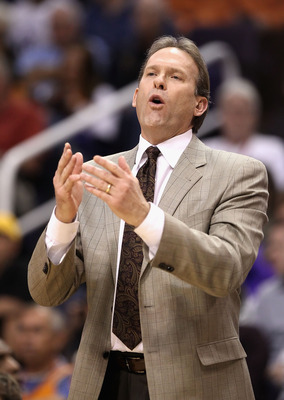 PHOENIX - DECEMBER 15:  Head coach Kurt Rambis of the Minnesota Timberwolves reacts during the NBA game against the Phoenix Suns at US Airways Center on December 15, 2010 in Phoenix, Arizona. The Suns defeated the Timberwolves 128-122.  NOTE TO USER: User
