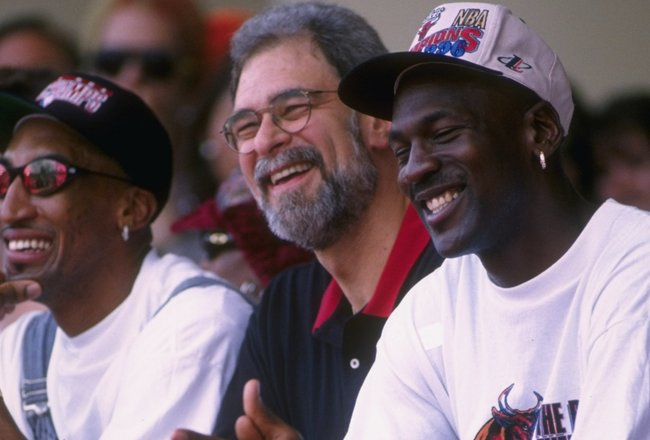 18 Jun 1996:  (L-R) Scottie Pippen, head coach Phil Jackson and Michael Jordan smile as they sit on the podium with the NBA CHampionship trophy during the Bulls victory parade in Chicago, Illinois, celebrating their 1996 NBA Championship.   Mandatory Cred