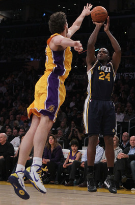 LOS ANGELES, CA - JANUARY 25:  Paul Millsap #24 of the Utah Jazz shoots over Pau Gasol #16 of the Los Angeles Lakers in the first half at Staples Center on January 25, 2011 in Los Angeles, California. NOTE TO USER: User expressly acknowledges and agrees t