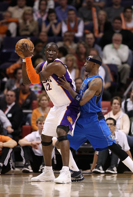 PHOENIX, AZ - FEBRUARY 17: Mickael Pietrus #12 of the Phoenix Suns looks to pass during the NBA game against the Dallas Mavericks at US Airways Center on February 17, 2011 in Phoenix, Arizona.  The Mavericks defeated the Suns 112-106.  NOTE TO USER: User