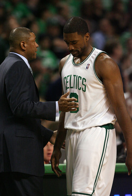 BOSTON - APRIL 18:  Head coach Doc Rivers of the Boston Celtics consoles Leon Powe #0 in the second half against the Chicago Bulls in Game One of the Eastern Conference Quarterfinals during the 2009 NBA Playoffs at TD Banknorth Garden on April 18, 2009 in