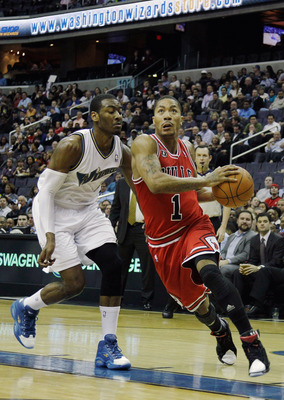 WASHINGTON, DC - FEBRUARY 28: Derrick Rose #1 of the Chicago Bulls drives to the basket while being guarded by John Wall #2 of the Washington Wizardsat the Verizon Center in Washington on February 28, 2011 in Washington, DC. NOTE TO USER: User expressly a