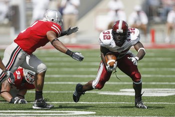 COLUMBUS, OH - SEPTEMBER 20:  DuJuan Harris #32 of the Troy Trojans carries the ball during the game against the Ohio State Buckeyes on September 20, 2008 at Ohio Stadium in Columbus, Ohio. Ohio State won the game 28-10. (Photo by Gregory Shamus/Getty Ima