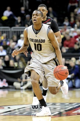 KANSAS CITY, MO - MARCH 10:  Alec Burks #10 of the Colorado Buffaloes moves the ball against the Texas Tech Red Raiders in the first half during the first round game of the 2010 Phillips 66 Big 12 Men's Basketball Tournament at the Sprint Center on March