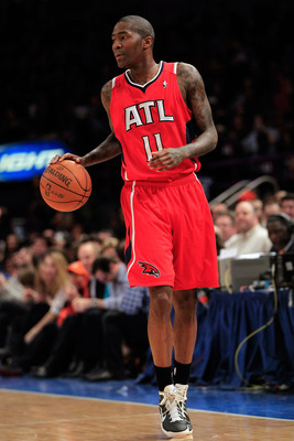 NEW YORK, NY - FEBRUARY 16: Jamal Crawford #11 of the Atlanta Hawks dribbles the ball against the New York Knicks at Madison Square Garden on February 16, 2011 in New York City. NOTE TO USER: User expressly acknowledges and agrees that, by downloading and