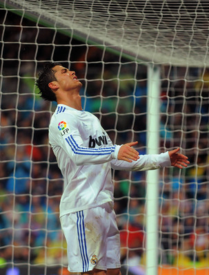 MADRID, SPAIN - FEBRUARY 19:  Cristiano Ronaldo of Real Madrid reacts after failing to score a goal  during the  La Liga match between Real Madrid and Levante at Estadio Santiago Bernabeu on February 19, 2011 in Madrid, Spain.  (Photo by Denis Doyle/Getty